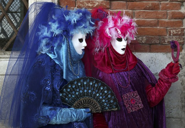 Masked revellers pose in St. Mark's Square during the Venice Carnival, February 7, 2015. (Photo by Stefano Rellandini/Reuters)