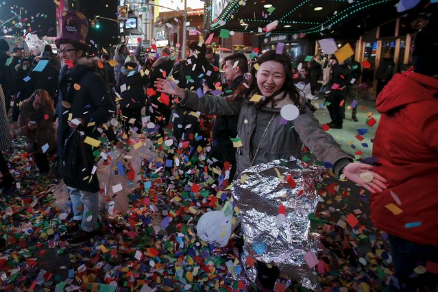 A reveler poses for a photo during New Year celebrations in the Manhattan borough of New York, January 1, 2016. (Photo by Carlo Allegri/Reuters)