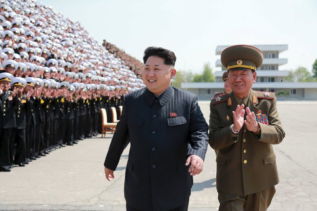 North Korean leader Kim Jong Un prepares for a photo session with the participants of the Fifth Conference of the Training Officers of the KPA, in this undated photo released by North Korea's Korean Central News Agency (KCNA) May 1, 2015. (Photo by Reuters/KCNA)
