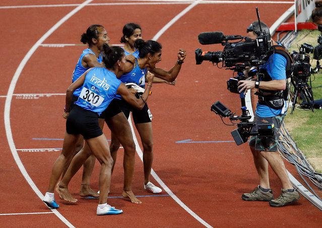 India' s 4x400 m relay team celebrate after winning the gold medal during the athletics competition at the 18 th Asian Games in Jakarta, Indonesia, Thursday, August 30, 2018. (Photo by Willy Kurniawan/Reuters)