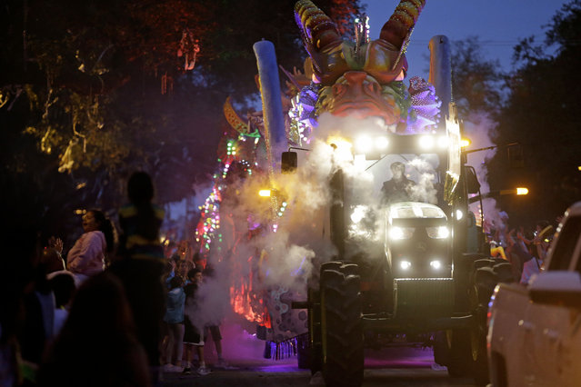 A float in the Krewe of Proteus passes down Napoleon Avenue during their Mardi Gras parade in New Orleans, Monday, February 16, 2015. (Photo by Gerald Herbert/AP Photo)