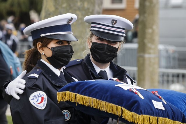 French police officers react during a remembrance gathering to pay respect to police official Stephanie Monferme, killed a week ago, in Rambouillet, southwest of Paris, Friday, April 30, 2021. France is holding a national ceremony Friday to pay tribute to a police official who was stabbed to death inside her police station in what authorities say was an Islamic extremist attack. (Photo by Ludovic Marin/Pool Photo via AP Photo)