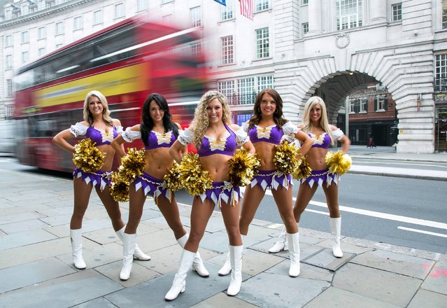 American NFL (National Football League) cheerleaders Blair, Jacqui, Lauryn, Ali and Missy from the Minnesota Vikings warm up on Regent Street, central London, on September 25, 2013, in preparation for NFL on Regent Street – the traffic free event on Saturday 28th September ahead of the Minnesota Vikings and Pittsburgh Steelers game at Wembley on Sunday 29th September. (Photo by John Phillips/PA Vire)