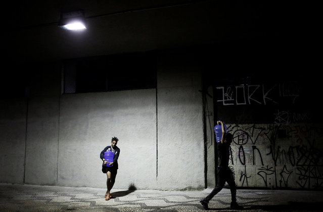 Teflon (L), 19, and Jorge, 31, who are among members of lesbian, gay, bisexual and transgender (LGBT) community, that have been invited to live in a building that the roofless movement has occupied, carry water bottles, in downtown Sao Paulo, Brazil, November 22, 2016. (Photo by Nacho Doce/Reuters)