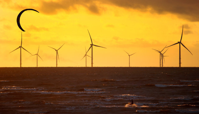 A man kite surfs in front of the Burbo Bank wind farm near New Brighton, Britain, September 3, 2018. (Photo by Phil Noble/Reuters)