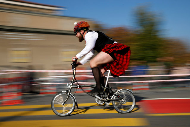 A participant races in the Brompton World Championship in Bern, Switzerland October 21, 2018. (Photo by Stefan Wermuth/Reuters)