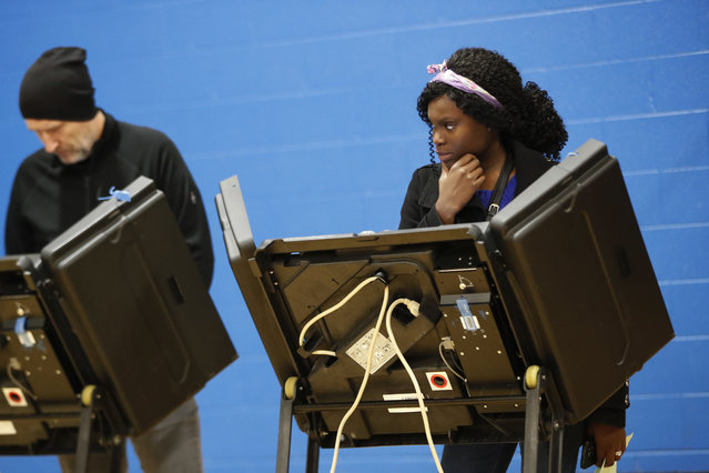 A voter waits for assistance from a volunteer at the Tuttle Park Recreation Center, Tuesday, November 6, 2018, in Columbus, Ohio. Across the country, voters headed to the polls Tuesday in one of the most high-profile midterm elections in years. (Photo by John Minchillo/AP Photo)