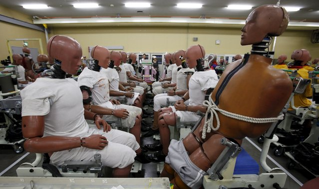 Toyota Motor Corp's crash-test dummies are pictured during the Toyota Safety Technology Media Tour at the company's Higashifuji Technical Center in Susono, west of Tokyo, in this July 21, 2011 file photo. Toyota is expected to report Q3 results this week. (Photo by Toru Hanai/Reuters)