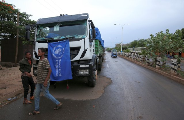 The World Food Program (WFP) convoy trucks carrying food items for the victims of Tigray war are seen parked after the checkpoints leading to Tigray Region were closed, in Mai Tsebri town, Ethiopia on June 26, 2021. (Photo by Reuters/Stringer)