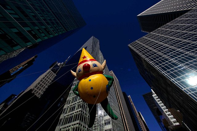 An elf balloon floats down Sixth Avenue. (Photo by Eric Thayer/Reuters)