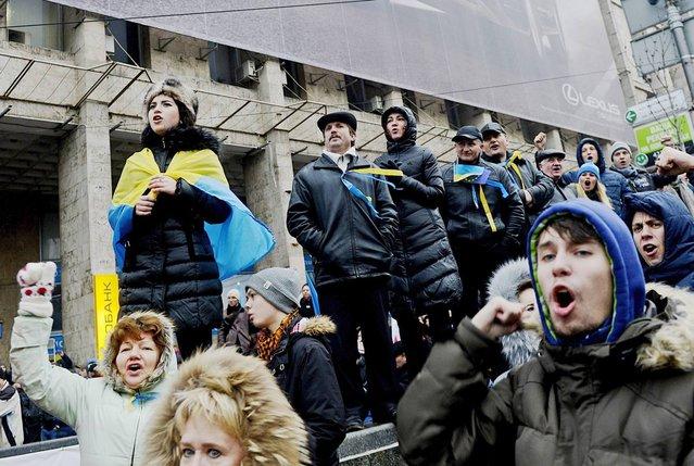 Protestors shouts slogans during a demonstration on Independent Square in Kiev, Ukraine, 01 December 2013. (Photo by Filip Singer/EPA/EFE)