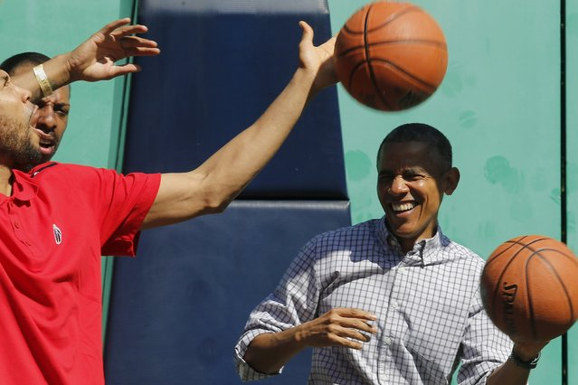U.S. President Barack Obama gets hit on the head by a rebound while playing basketball, an exercise activity during the annual Easter Egg Roll at the White House in Washington April 6, 2015. (Photo by Jonathan Ernst/Reuters)