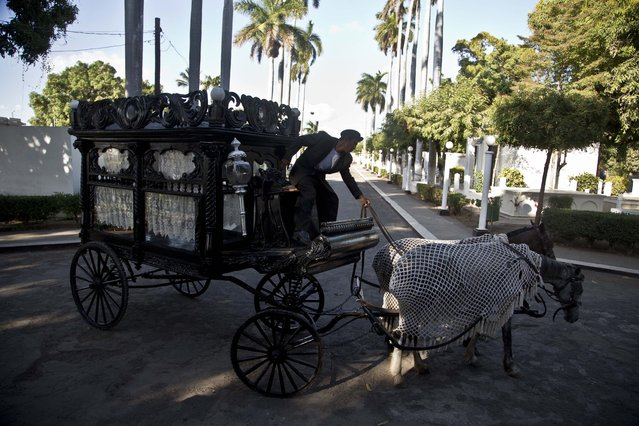 A horse drawn hearse makes its way inside a local cemetery in Granada, Nicaragua, Wednesday, April 8, 2015. (Photo by Esteban Felix/AP Photo)