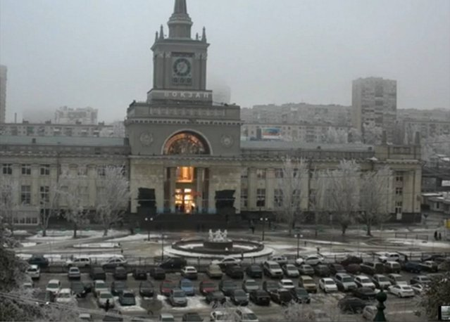 In this photo made by a public camera and made available by the Associated Press Television News the flash of an explosion illuminates the entrance to  Volgograd railway station in Volgograd Russia  on Sunday, December 29, 2013. More then a dozen people were killed and scores were wounded Sunday by a suicide bomber at a railway station in southern Russia, officials said, heightening concern about terrorism ahead of February's Olympics in the Black Sea resort of Sochi. (Photo by AP Photo/Associated Press Television News)