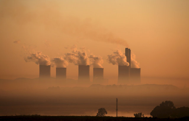 Steam rises at sunrise from the  Lethabo Power Station, a coal-fired power station owned by state power utility ESKOM near Sasolburg, South Africa, March 2, 2016. (Photo by Siphiwe Sibeko/Reuters)