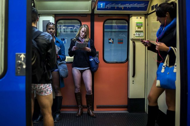 Participants travel on the train without their pants during the 5th annual No Pants Subway Ride in Madrid. (Photo by Andres Kudacki/Associated Press)