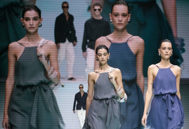 Models wear creations for the Emporio Armani Spring Summer 2022 collection during Milan Fashion Week, in Milan, Italy, Thursday, September 23, 2021. (Photo by Luca Bruno/AP Photo)