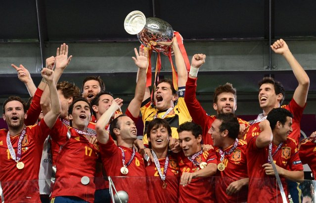 Spanish players celebrate after winning the Euro 2012 football championships final match Spain vs Italy on July 1, 2012 at the Olympic Stadium in Kiev. (Photo by Franck Fife/AFP Photo)