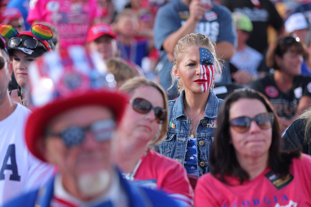 A supporter is seen with half her face painted in the colors of the U.S. flag during a rally attended by former U.S. President Donald Trump in Perry, Georgia, U.S. September 25, 2021. The former president expressed support for Herschel Walker, a controversial former NFL running back hoping to challenge the Democratic senator Raphael Warnock in midterm elections next year. (Photo by Dustin Chambers/Reuters)