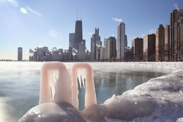 Ice forms along the shore of Lake Michigan as temperatures hovered around -10 degrees on January 28, 2014 in Chicago, Illinois. The city has had 18 days at or below zero so far this winter, two shy of the 20-day record. (Photo by Scott Olson/Getty Images)