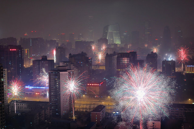 Fireworks illuminate the skyline to celebrate Chinese Lunar New Year of Horse and cause severe air pollution on January 30, 2014 in Beijing, China. (Photo by Feng Li/Getty Images)