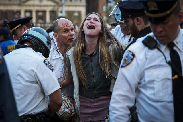 A protester is detained by New York police during a demonstration calling for social, economic and racial justice, in the Manhattan borough of New York City April 29, 2015. The demonstration was being held to support Baltimore's protest against police brutality following the April 19 death of Freddie Gray in police custody. (Photo by Andrew Kelly/Reuters)