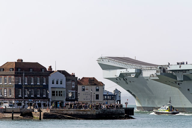 HMS Queen Elizabeth leaves Portsmouth Harbour, England on its way back to dry-docks in Rosyth for maintenance work on April 1, 2019. (Photo by James Marsh/Shutterstock)