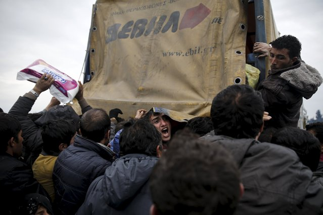 A man (C) shouts as refugees and migrants grab goods donated by volunteers from a truck at a makeshift camp at the Greek-Macedonian border, near the village of Idomeni, Greece March 16, 2016. (Photo by Alkis Konstantinidis/Reuters)