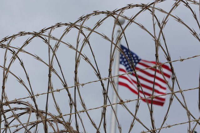 The United States flag flies inside of Joint Task Force Guantanamo Camp VI at the U.S. Naval Base in Guantanamo Bay, Cuba March 22, 2016. (Photo by Lucas Jackson/Reuters)