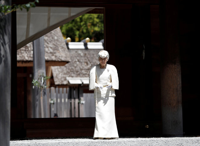 Japan's Empress Michiko walks from the main sanctuary as she visits at Outer shrine of the Ise Jingu shrine, ahead of Emperor Akihito's April 30, 2019 abdication, in Ise, central Japan, April 18, 2019. (Photo by Issei Kato/Reuters)