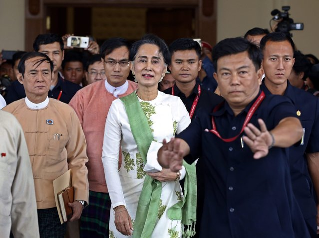 Myanmar's democracy leader Aung San Suu Kyi (C) leaves after a meeting with parliament members of her National League for Democracy (NLD) party at the ZabuThiri Hall of the Myanmar parliament, in Naypyitaw, Myanmar, 28 March 2016. Others are not identified. (Photo by Nyein Chan Naing/EPA)