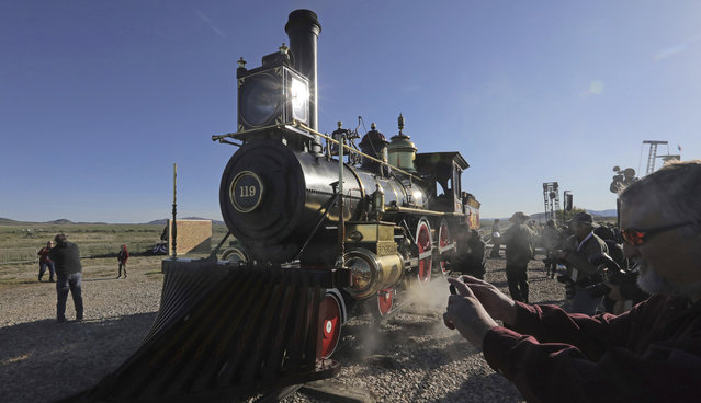 The Union Pacific No. 119, arrives for the the commemoration of the 150th anniversary of the Transcontinental Railroad completion at the Golden Spike National Historical Park Friday, May 10, 2019, in Promontory, Utah. People from all over the country are gathering at a remote spot in Utah to celebrate Friday's 150th anniversary of the completion of the Transcontinental Railroad. (Photo by Rick Bowmer/AP Photo)