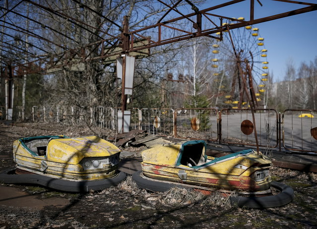 A view of an amusement park in the centre of the abandoned town of Pripyat near the Chernobyl nuclear power plant in Ukraine on March 28, 2016. (Photo by Gleb Garanich/Reuters)
