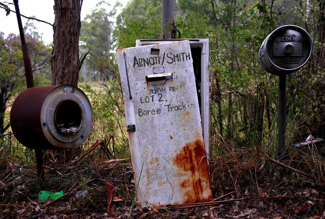 An old refrigerator sits between an old washing machine and a beer keg, all of which are being used as mailboxes, along a road on the outskirts of the township of Wollombi, located north of Sydney, Australia, February 25, 2017. (Photo by David Gray/Reuters)