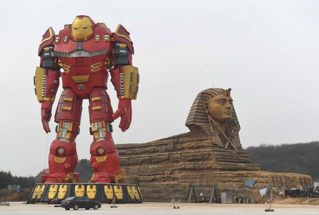 A giant Iron Man statue stands next to a replica Sphinx in Chuzhou, Anhui Province, China on February 21, 2017. (Photo by Sipa Asia/Rex Features/Shutterstock)