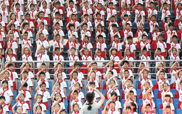Young pioneers from a primary school salute during an event to celebrate Children's Day, which falls in Quanzhou, Fujian province, China on June 1, 2019. (Photo by Reuters/China Stringer Network)