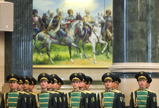 Turkmen honor guards line up during a meeting of Turkmenistan's President Gurbanguly Berdymukhammedov with his Ukrainian counterpart Viktor Yanukovich in Ashgabat, February 13, 2013. (Photo by Mykhailo Markiv/Reuters/Ukrainian Presidential Press Service)