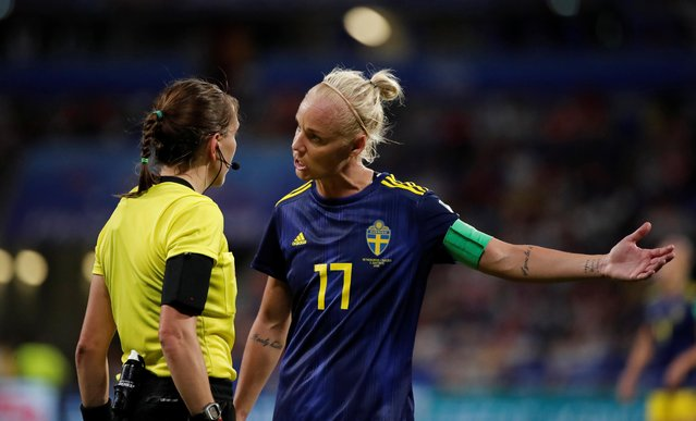 Sweden's midfielder Caroline Seger (R) argues with the Canadian referee Marie-Soleil Beaudoin (L) during the France 2019 Women's World Cup semi-final football match between the Netherlands and Sweden, on July 3, 2019, at the Lyon Stadium in Decines-Charpieu, central-eastern France. (Photo by Benoit Tessier/Reuters)
