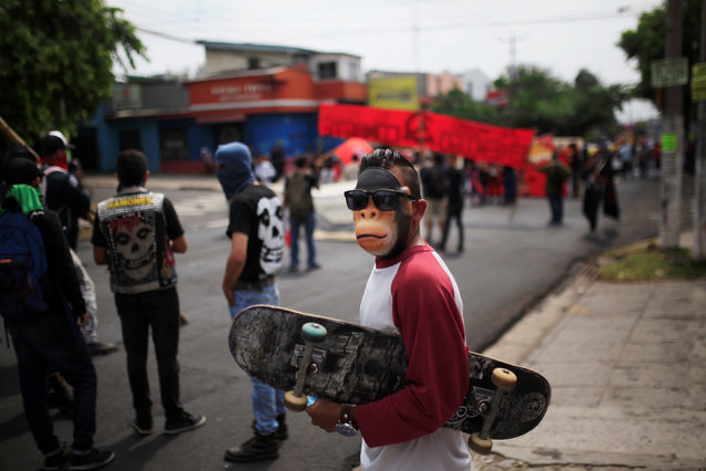 A masked skateboarder participates in the May Day march in San Salvador, El Salvador May 1, 2016. (Photo by Jose Cabezas/Reuters)