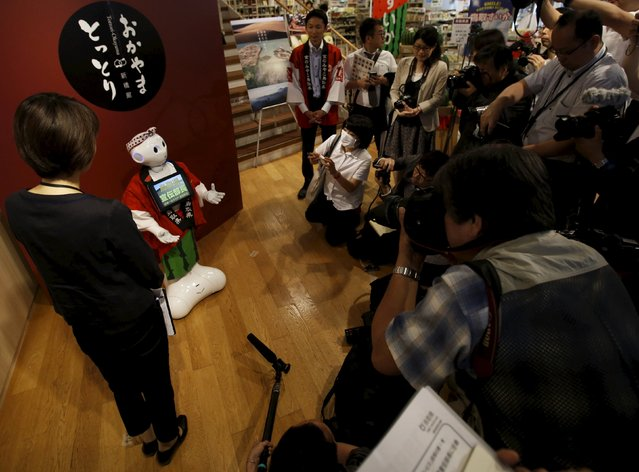"SoftBank's human-like robot named ""Pepper"" is photographed in its role as a PR manager of Tottori prefecture at the prefecture speciality store in Tokyo, Japan, July 1, 2015. (Photo by Yuya Shino/Reuters)"