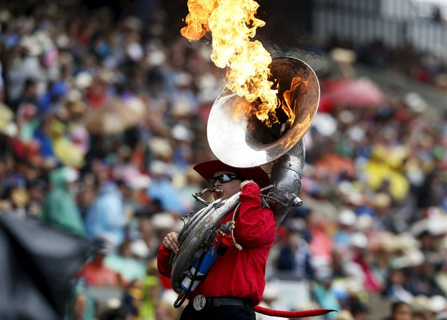 A member of the Calgary Stampede Show Band performs at the start of Championship Sunday at the finals of the Calgary Stampede rodeo in Calgary, Alberta, July 12, 2015. (Photo by Todd Korol/Reuters)