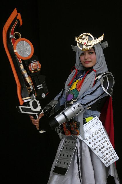 "Ange, a young Indonesian Muslim cosplayer dressed as the Kamen rider Gaim, takes part in the ""Hijab Cosplay"" event in Subang Jaya, outside of Kuala Lumpur, on April 29, 2017. (Photo by Manan Vatsyayana/AFP Photo)"
