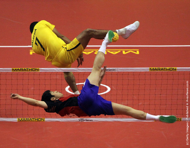Sepaktakraw: South Korea's Im An Soo returns a shot in the men's semi-final match against Malaysia during day three of the ISTAF Super Series at the Palembang Sport Convention Center