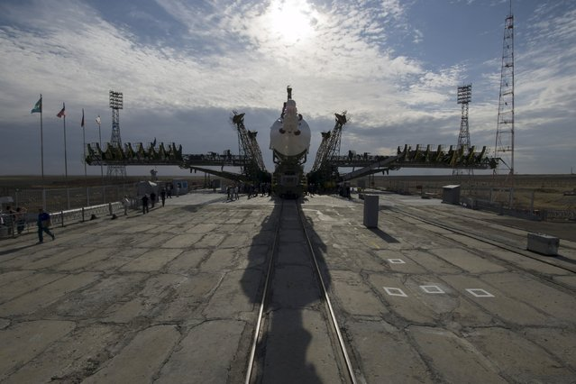 The Soyuz TMA-17M spacecraft is ready to be lifted to its launch pad at the Baikonur cosmodrome, Kazakhstan, July 20, 2015. (Photo by Shamil Zhumatov/Reuters)