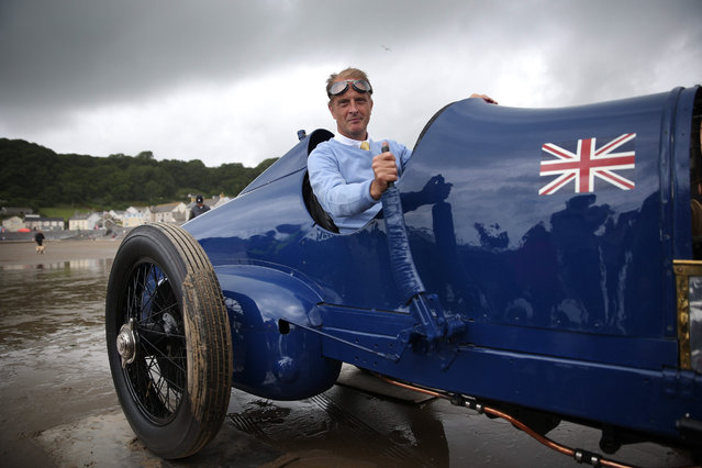 Don Wales sits in the original Sunbeam car as he prepares to recreate his grandfather's 1925 land speed world record at Pendine Sands on July 21, 2015 in Carmarthen, Wales. Sir Malcolm Campbell drove his 350 hp Sunbeam on July 21, 1925 on the sands at Pendine to reach a new world record of speed of 150.76 miles per hour. The car was bought in 1957 and restored by Lord Montague for his National Motor Museum at Beaulieu in Hampshire. (Photo by Peter Macdiarmid/Getty Images)