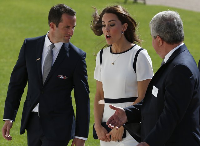 Kate the Duchess of Cambridge meets officials as she arrives at the National Maritime Museum, Greenwich, south London, Tuesday, June 10, 2014. The Duchess met with supporters of the bid to launch a British team for the America's Cup, along with crew members and boat designers. (Photo by Lefteris Pitarakis/AP Photo)