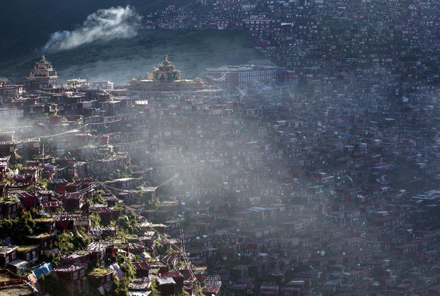 A view shows the settlements of Larung Gar Buddhist Academy in Sertar County of Garze Tibetan Autonomous Prefecture, Sichuan province, China, July 24, 2015. (Photo by Reuters/Stringer)
