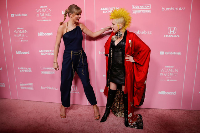 """Singer Taylor Swift greets Cyndi Lauper as they arrive on the red carpet for the """"Billboard Women in Music"""" event in Los Angeles, California, U.S., December 12, 2019. (Photo by Mike Blake/Reuters)"""