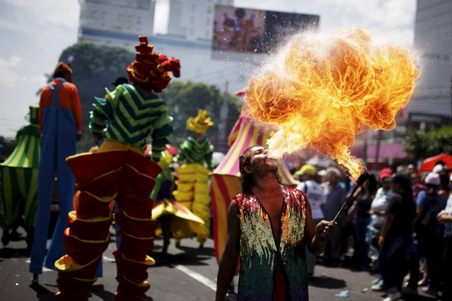 A performer spits fire during the opening parade of the festivities of El Divino Salvador del Mundo (The Divine Savior of The World), patron saint of the capital city of San Salvador, El Salvador August 1, 2015. (Photo by Jose Cabezas/Reuters)
