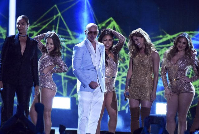 Singer Pitbull with Leona Lewis (L) and Cassadee Pope perform during the 2016 CMT Music Awards in Nashville, Tennessee U.S. June 8, 2016. (Photo by Harrison McClary/Reuters)